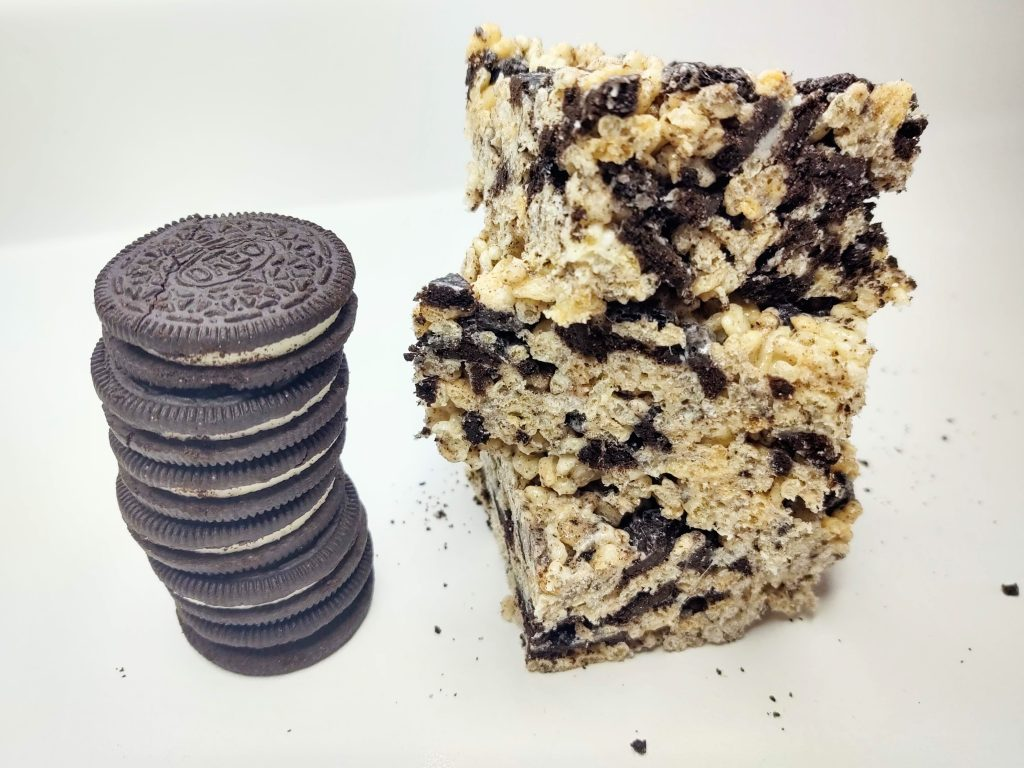 3 Oreo Rice Krispie Treats stacked next to a stack of 3 Double Stuffed Oreos