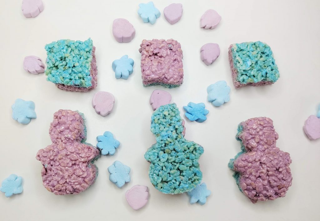 Finished Frozen themed Rice Krispie Treats cut into squares and snowmen shapes