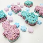 Snowman and square shaped blue and purple rice krispie treats. Blue snowflake and purple snowman head shaped marshmallows.