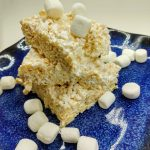 closeup of marshmallow fluff rice krispie treats surrounded by mini marshmallows