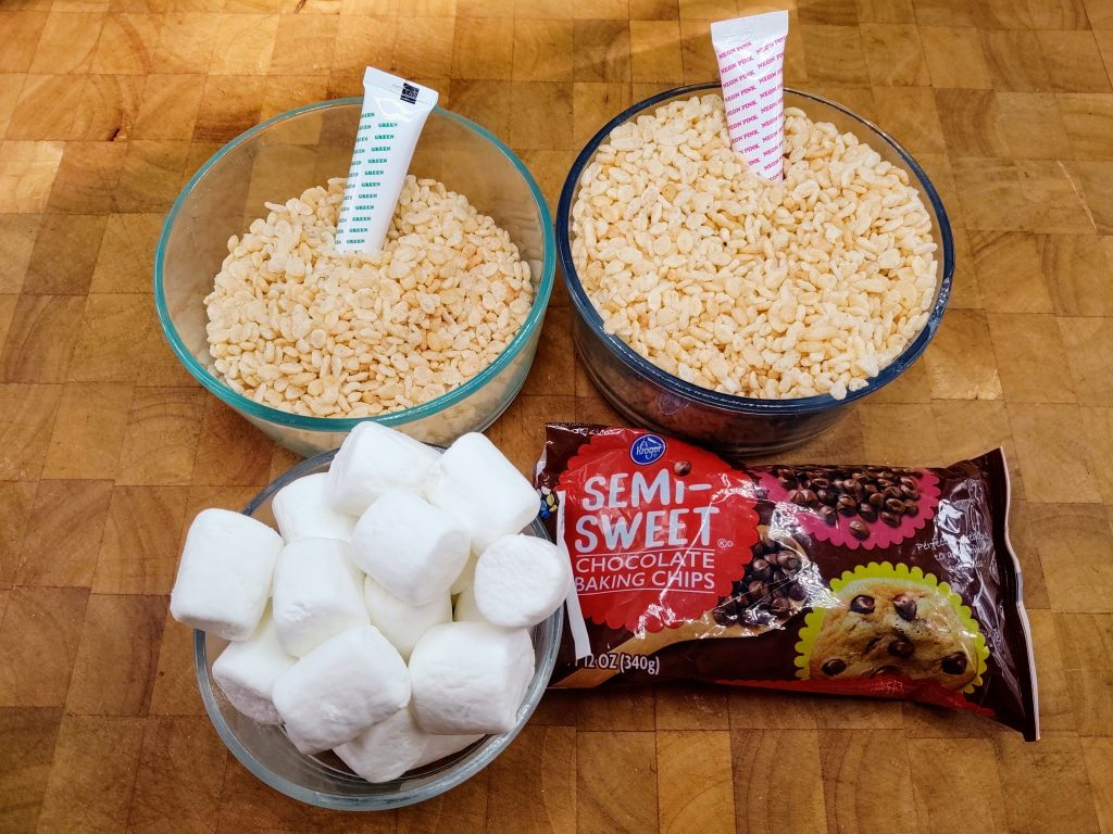ingredients for watermelon rice krispie treats; rice krispies, food coloring, marshmallows, chocolate chips