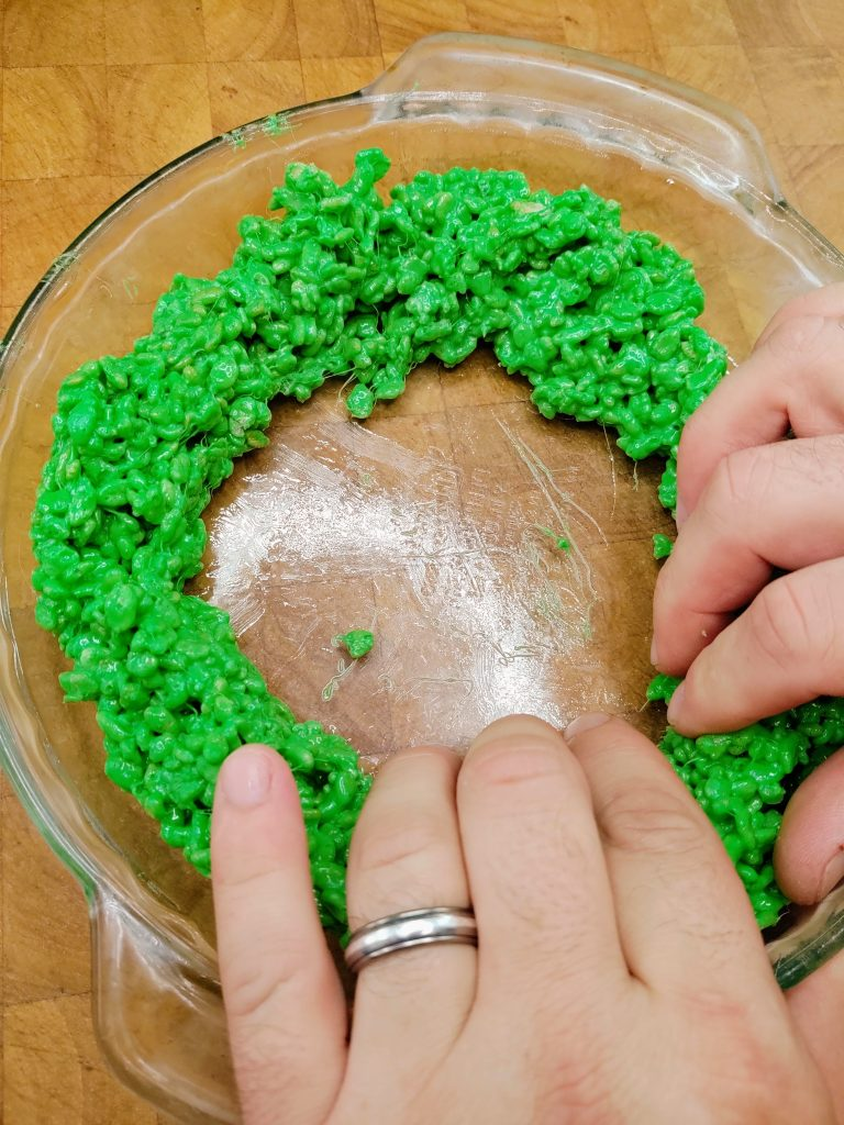 molding green ring (rind) around inside edge of pie pan by hand