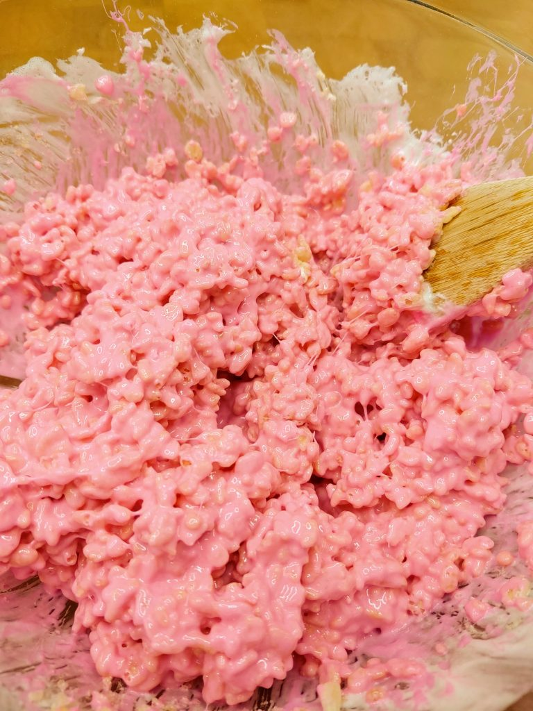 rice krispies mixed with pink melted marshmallows