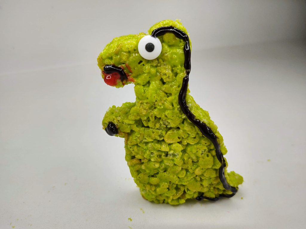 fully decorated T-rex shaped rice krispie treat