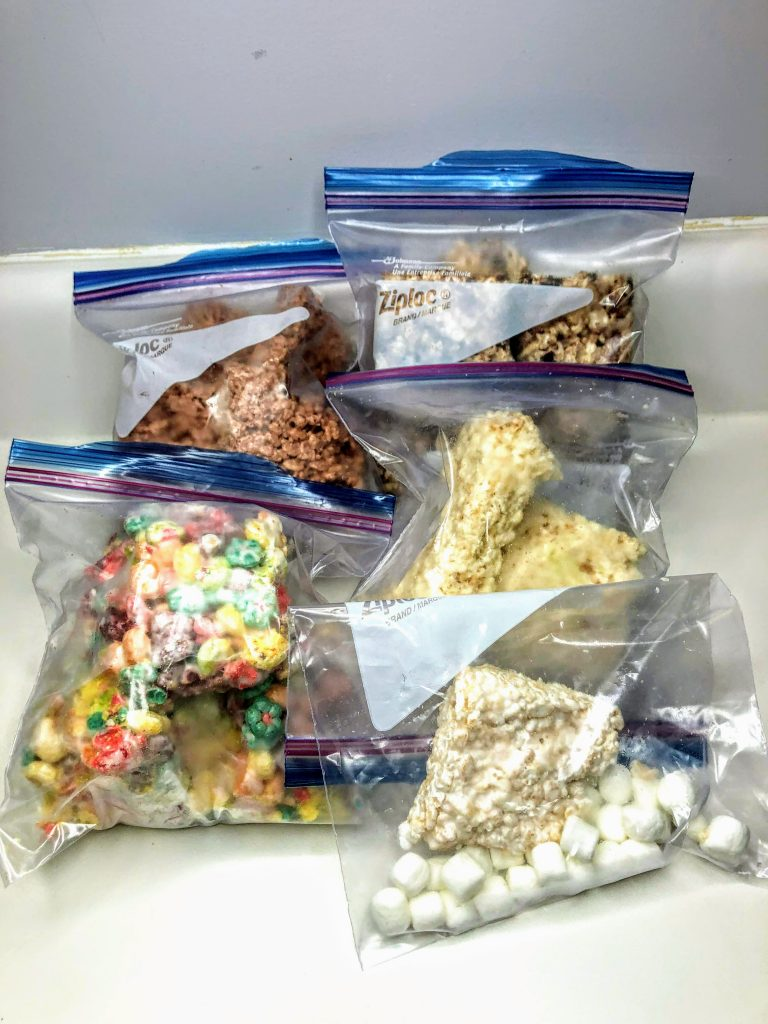 featured image for freezing rice krispie treats. 5 bags of various types of frozen rice krispie treats.